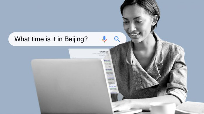 "Person searching on a lap top for ""what time is it in Beijing?"""